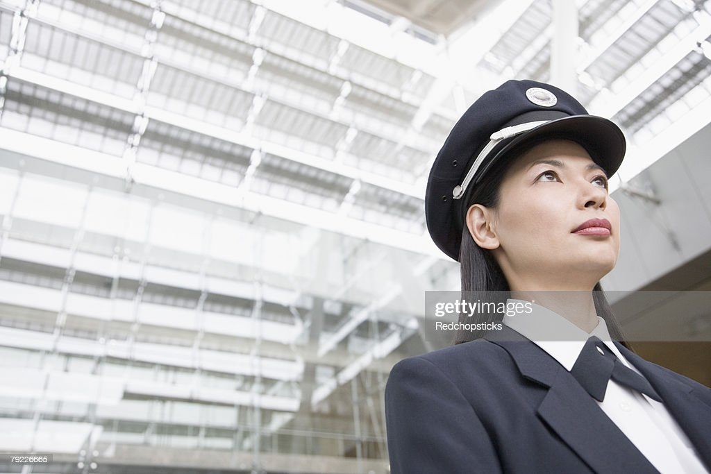 Low angle view of a female pilot : Stock Photo