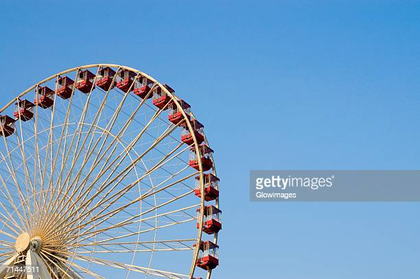 Low angle view of a ferris wheel in an amusement park, Navy Pier Park, Chicago, Illinois, USA