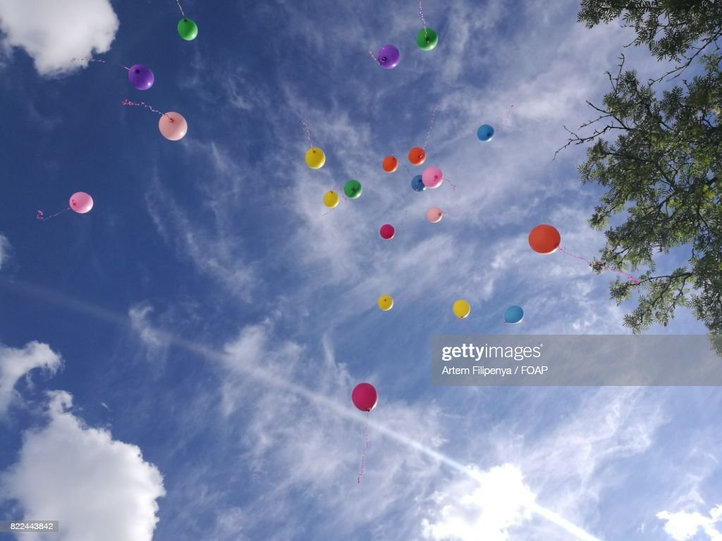 Low angle view of a flying balloon : Stock Photo