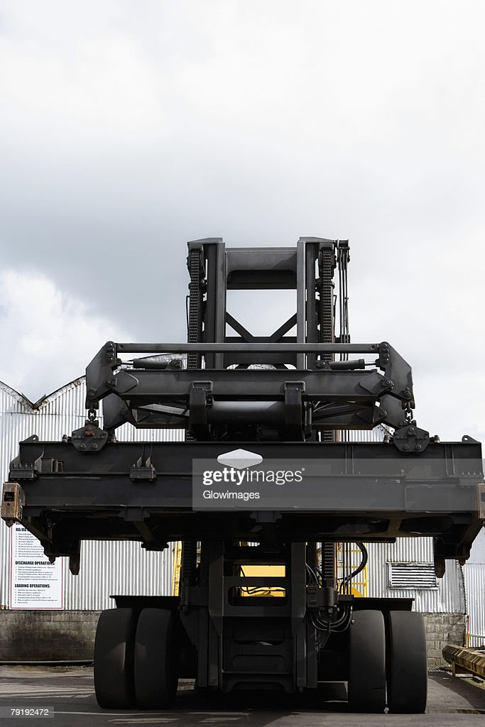 Low angle view of a forklift at a commercial dock : Stock Photo