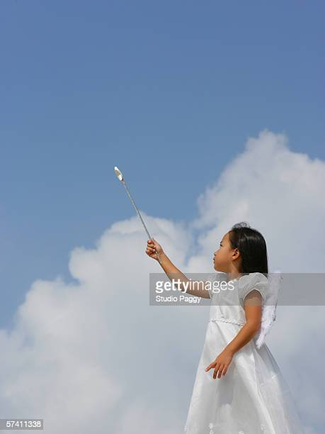 Low angle view of a girl dressed as a fairy