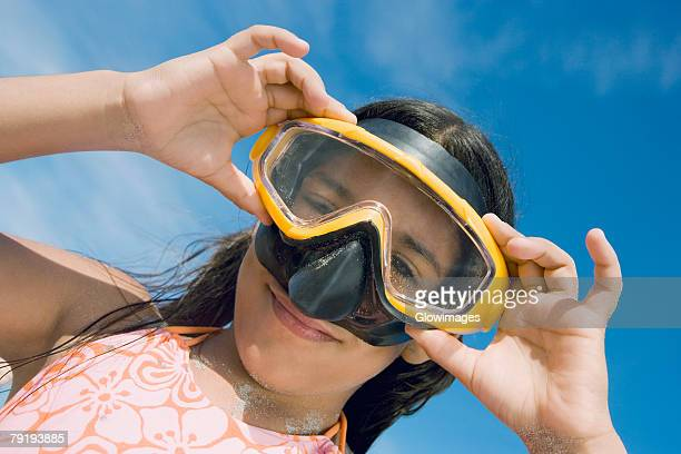 Low angle view of a girl wearing a scuba mask