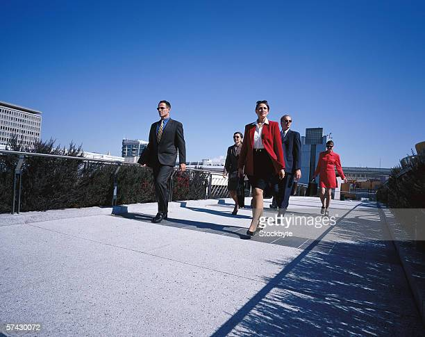 Low angle view of a group of business executives walking together outdoors