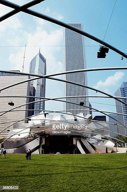 Low angle view of a group of people standing on the lawn, Jay Pritzker Pavilion, Chicago, Illinois, USA