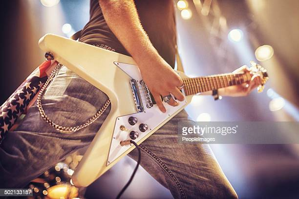 playing from his soul - rock and roll stock photos and pictures