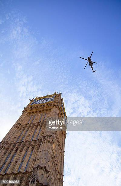 Low angle view of a helicopter flying over Big Ben, London, England, UK