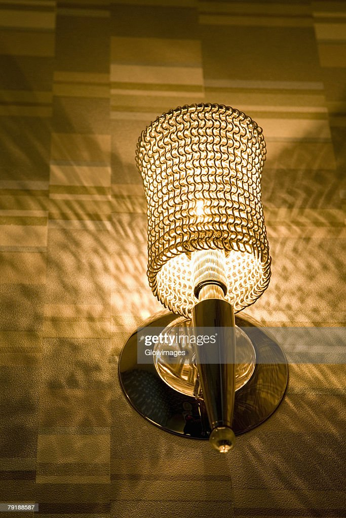 Low angle view of a lamp lit up at night : Foto de stock