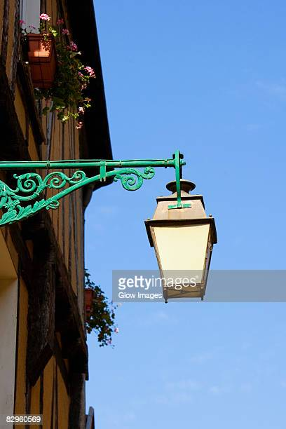 low angle view of a lantern mounted on the wall, le mans, sarthe, pays-de-la-loire, france - sarthe stock pictures, royalty-free photos & images