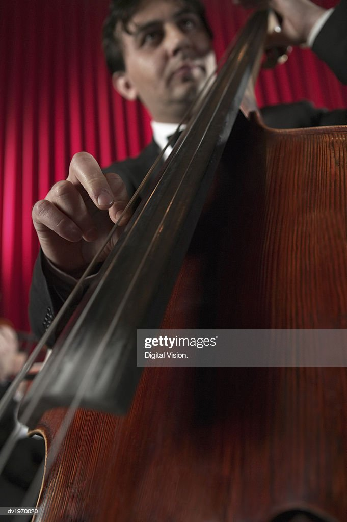Low Angle View of a Male Cellist : Stock Photo