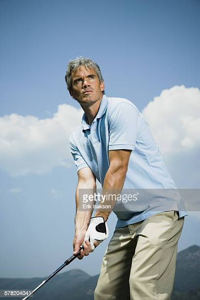 Low angle view of a man playing golf