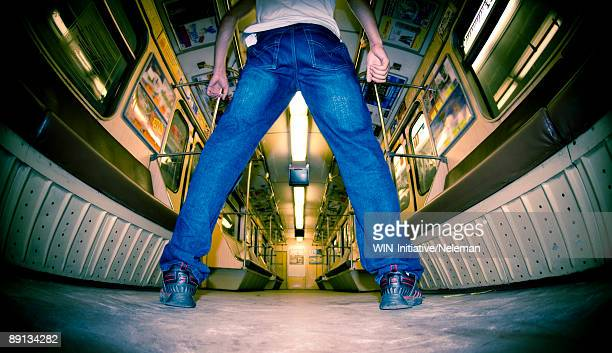 Low angle view of a man standing in a subway train, Kiev, Ukraine