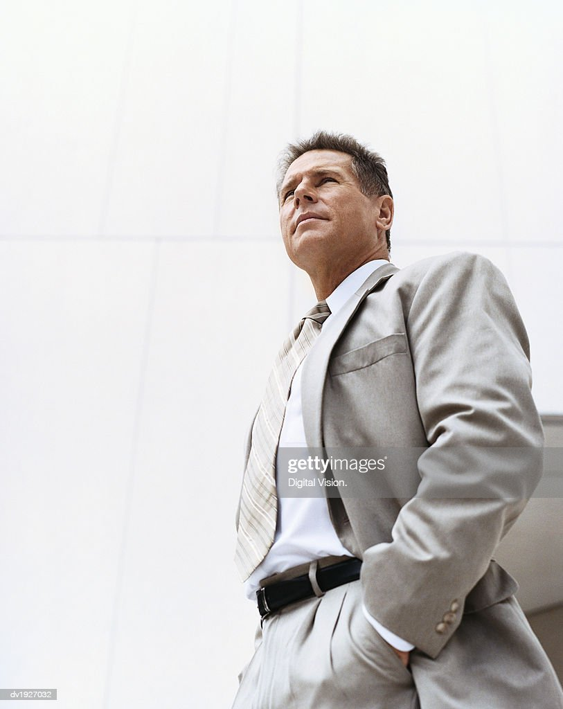 Low Angle View of a Mature Businessman Standing With His Hands in His Pockets : Stock Photo