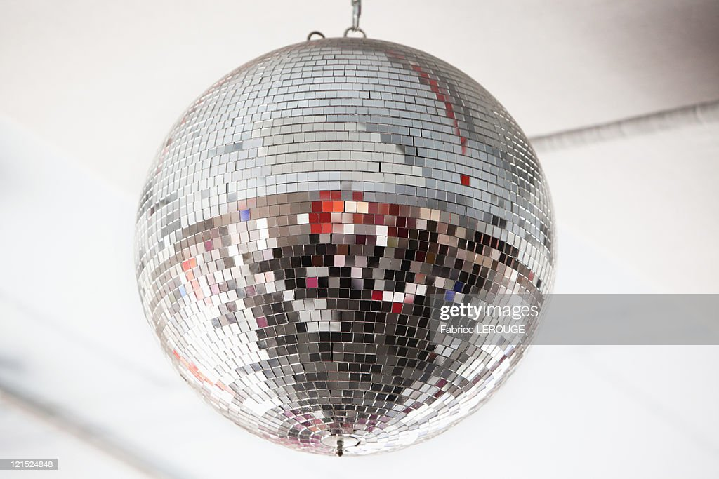 Low angle view of a mirrored disco ball in a nightclub : Stock Photo