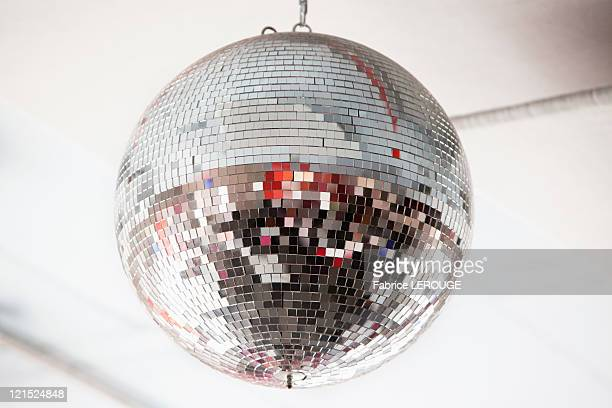 low angle view of a mirrored disco ball in a nightclub - disco ball stock photos and pictures