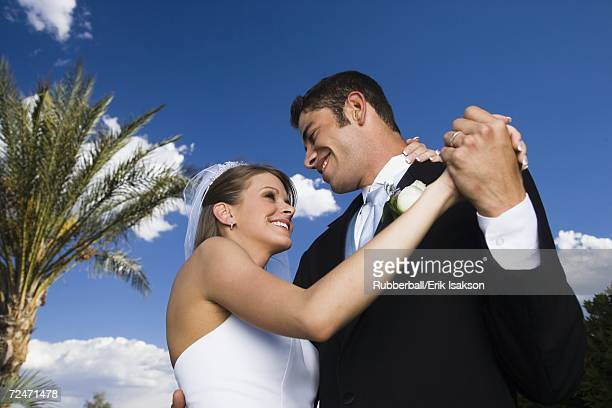 Low angle view of a newlywed couple dancing