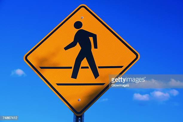 low angle view of a pedestrian crossing sign - pedestrian crossing sign stock photos and pictures