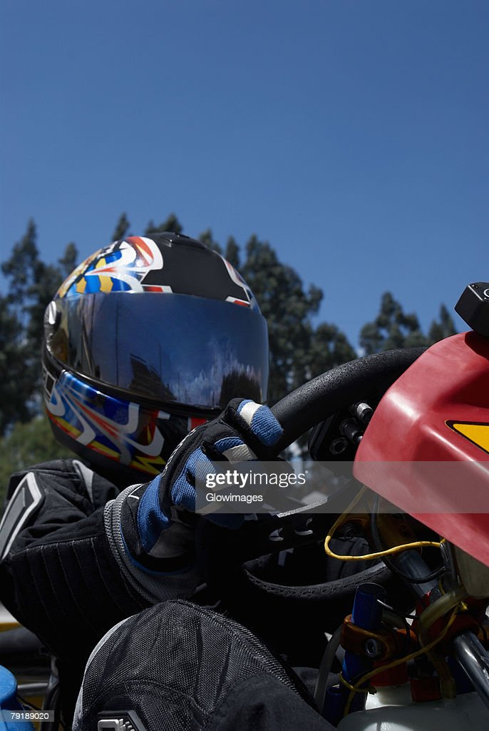 Low angle view of a person go-carting : Stock Photo
