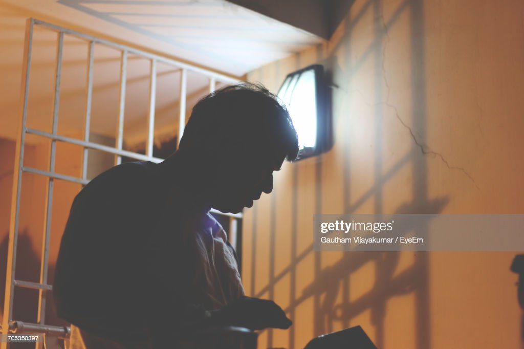 Low Angle View Of A Prisoner In Cell : Stock Photo