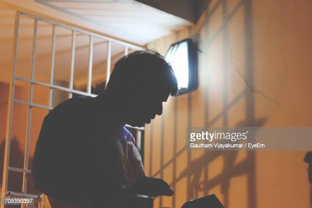 Low Angle View Of A Prisoner In Cell