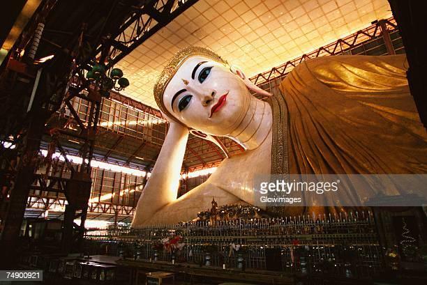 Low angle view of a Reclining Buddha in a pagoda, Chauk Htat Gyi Pagoda, Yangon, Myanmar