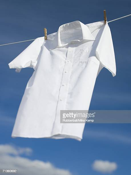 Low angle view of a shirt hanging on a clothesline
