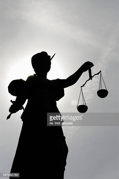 low angle view of a silhouette of the statue justitia - lady justice stock pictures, royalty-free photos & images