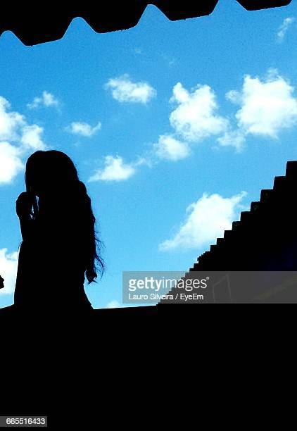low angle view of a silhouette woman against blue sky - lauro stock pictures, royalty-free photos & images