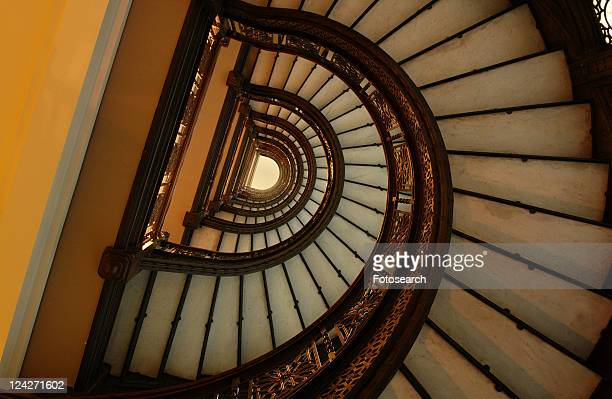 low angle view of a spiral staircase - rookery building stock pictures, royalty-free photos & images