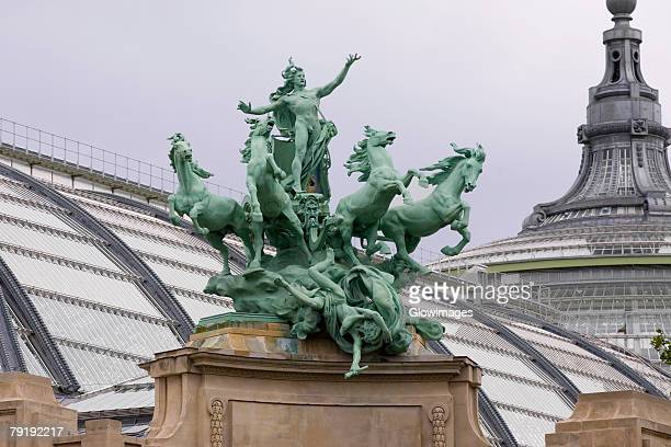 Low angle view of a statue on a building, Galeries Nationales du Grand Palais, Paris, France