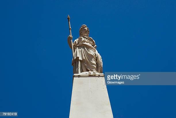 Low angle view of a statue on a monument, Piramide De Mayo, Plaza De Mayo, Barrio De Monserrat, Buenos Aires, Argentina