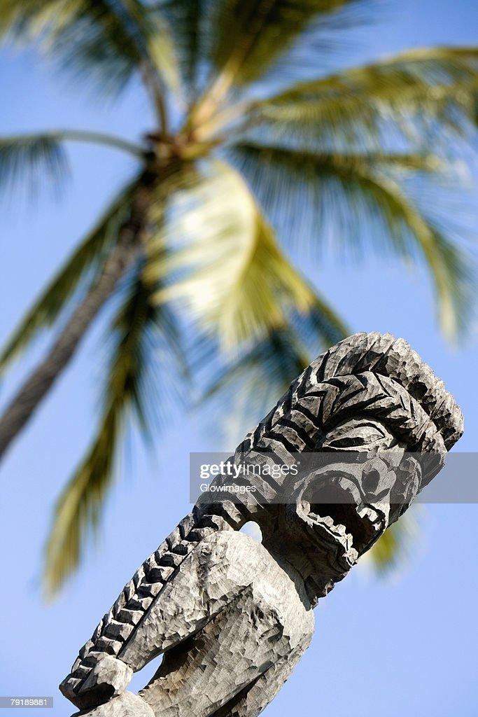 Low angle view of a tiki torch, City Of Refuge, Kona Coast, Puuhonua O Honaunau National Historical Park, Big Island, Hawaii Islands, USA : Stock Photo