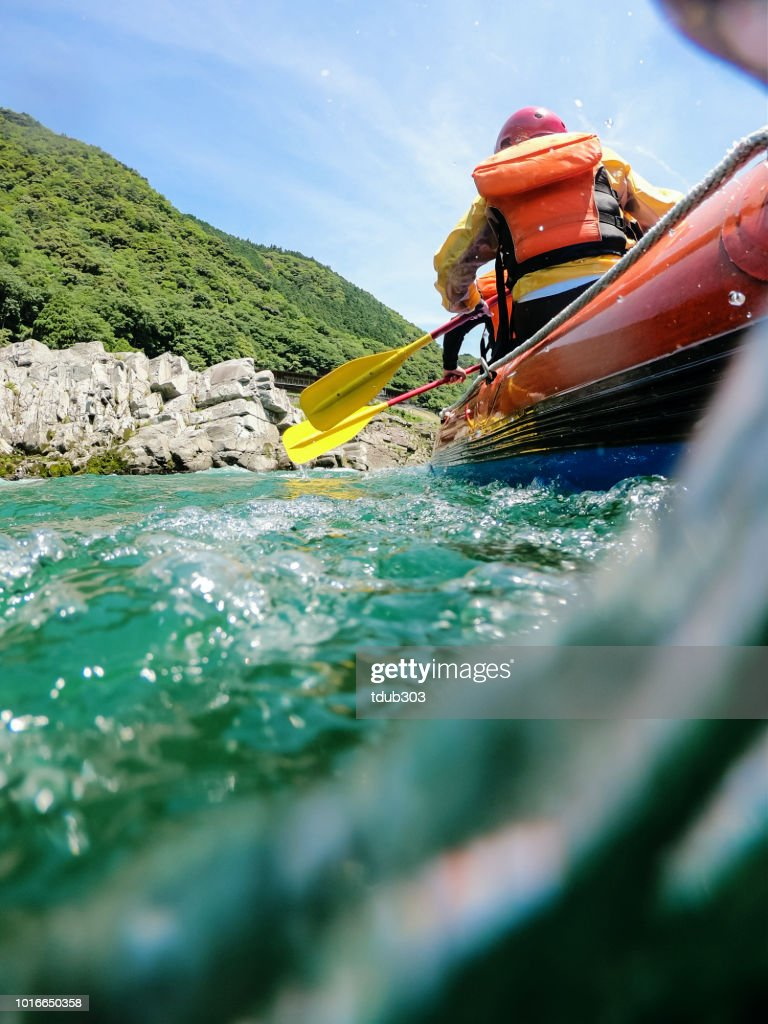 Low angle view of a white water river rafting excursion : Stock Photo