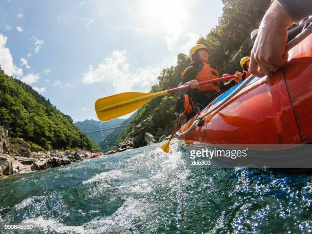 low angle view of a white water river rafting excursion - rafting stock pictures, royalty-free photos & images