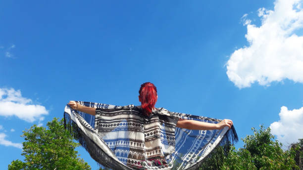 Low Angle View Of A Woman Against Blue Sky