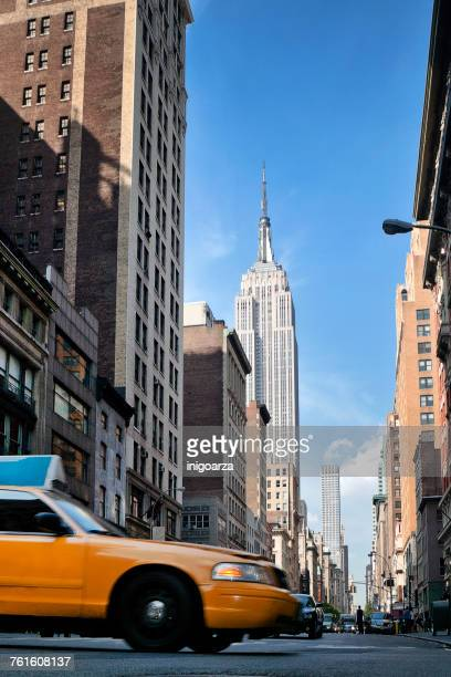 Low angle view of a yellow cab on 5th Avenue, Manhattan, New York, America, USA