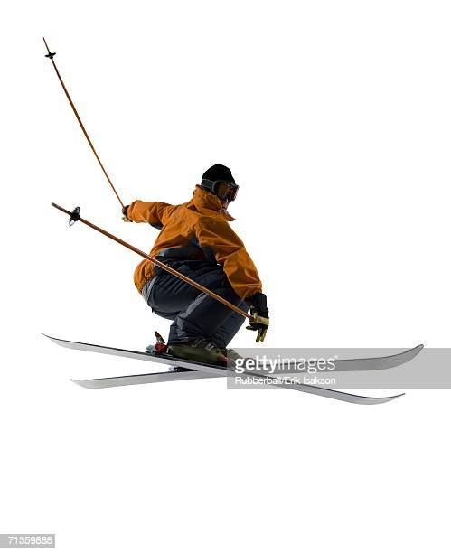 Low angle view of a young man skiing