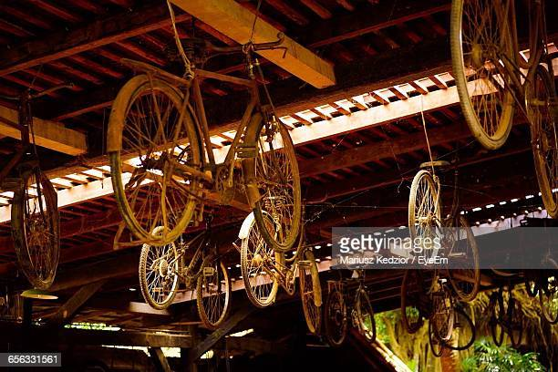 Low Angle View Of Abandoned Bicycles Hanging From Ceiling