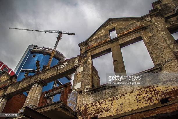 Low Angle View Of Abandoned Building Against Cloudy Sky