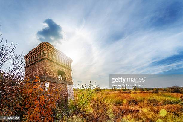 low angle view of abandoned building against sky - run down stock pictures, royalty-free photos & images