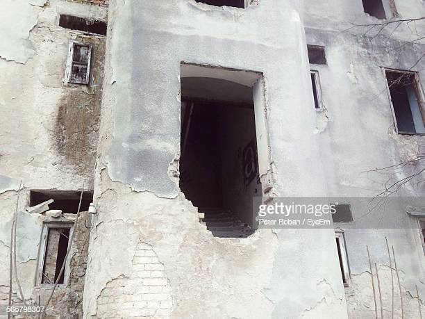 low angle view of abandoned building - boban stock pictures, royalty-free photos & images