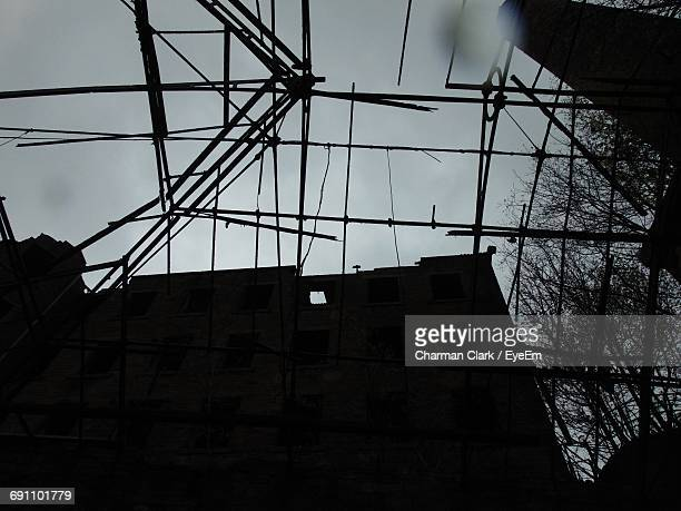 Low Angle View Of Abandoned Building Seen Through Broken Roof