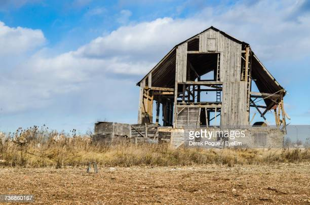 Low Angle View Of Abandoned Built Structure On Field Against Sky