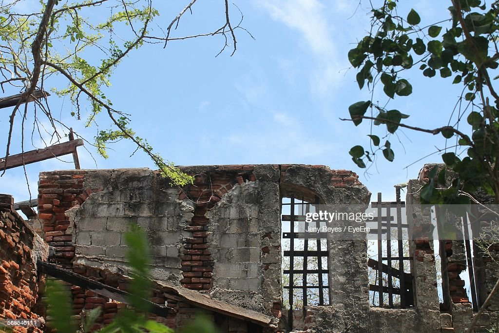 Low Angle View Of Abandoned House Against Sky : Stock Photo