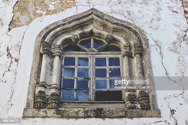 Low angle view of abandoned house window