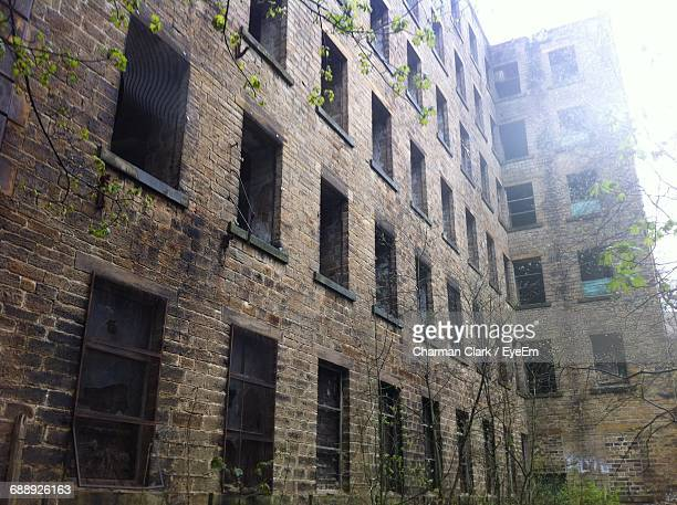 Low Angle View Of Abandoned Mill