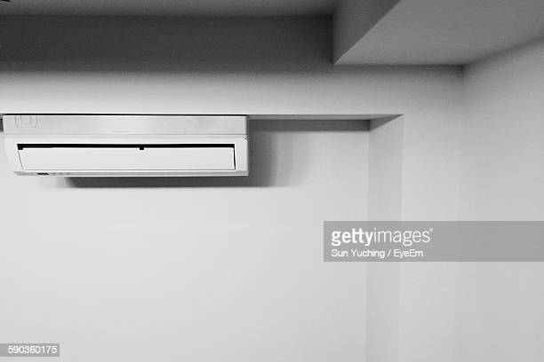 Low Angle View Of Air Conditioner On Wall At Home