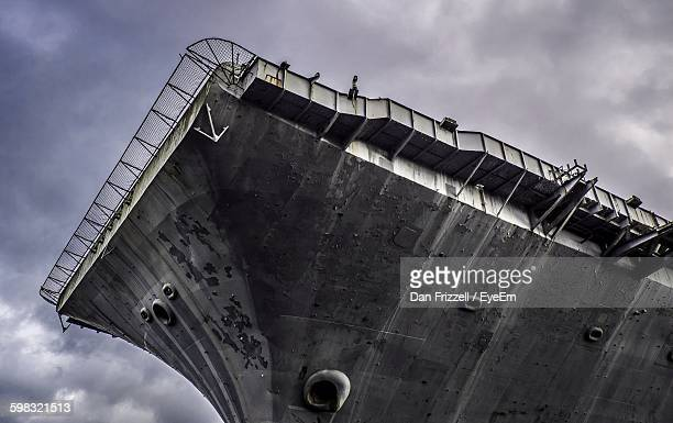 low angle view of aircraft carrier against cloudy sky - military ship stock pictures, royalty-free photos & images