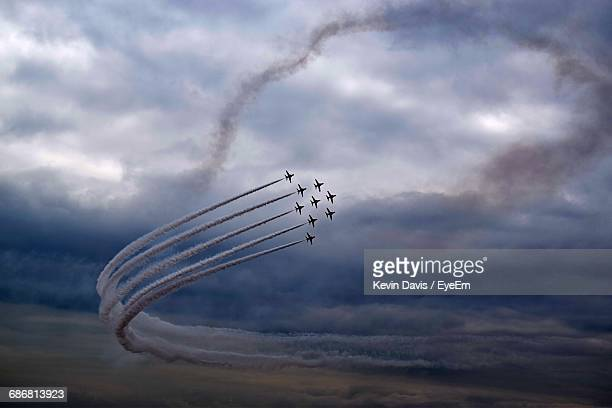Low Angle View Of Aircrafts Performing In Storm Clouds