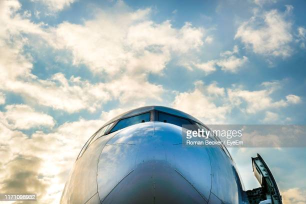low angle view of airplane against sky - aerospace stock pictures, royalty-free photos & images