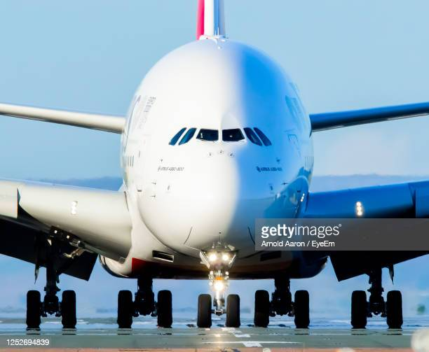 low angle view of airplane against sky - united arab emirates stock pictures, royalty-free photos & images